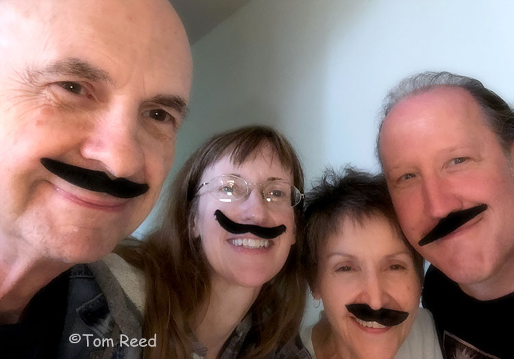 A picture of the Corben Studios Staff, all wearing fake moustaches.