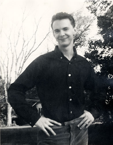 Richard Corben as a young man in front of his Kansas City home.